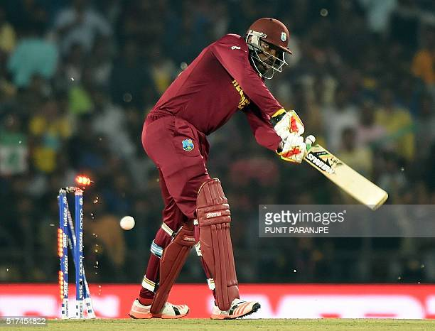 West Indies batsman Chris Gayle is bowled during the World T20 cricket tournament match between South Africa and West Indies at The Vidarbha Cricket...
