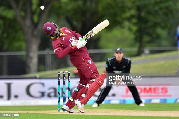 TOPSHOT West Indies batsman Chris Gayle is hit by a ball during the third oneday international cricket match between New Zealand and the West Indies...