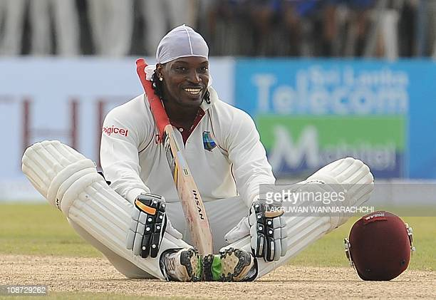 West Indies batsman Chris Gayle reacts after scoring a century during the first day of the first Test match between Sri Lanka and West Indies at The...