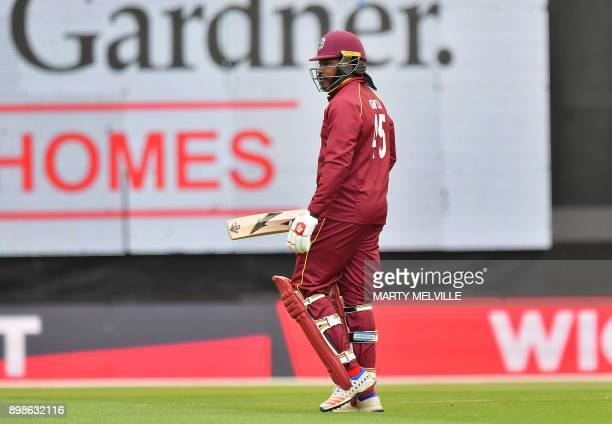 West Indies batsman Chris Gayle walks from the field after being dismissed during the third oneday international cricket match between New Zealand...
