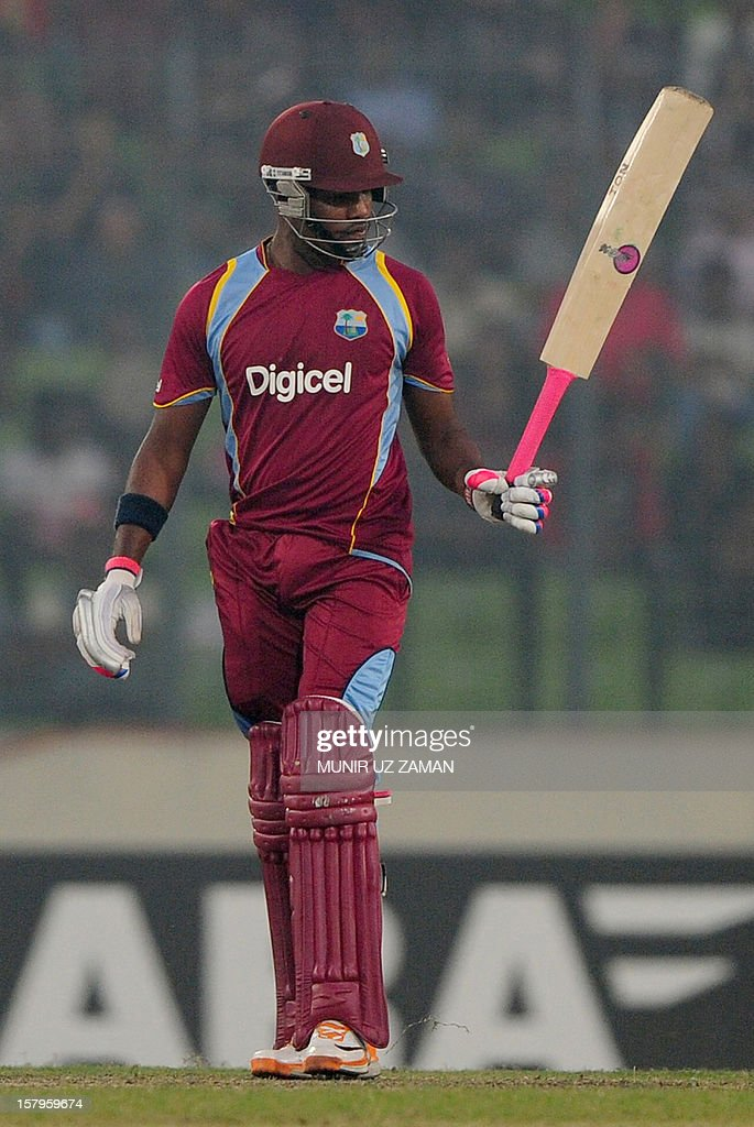West Indies batsman Darren Bravo acknowledges the crowd after scoring a half century (50 runs) during the fifth one day international between Bangladesh and West Indies at The Sher-e-Bangla National Cricket Stadium in Dhaka on December 8, 2012. AFP PHOTO/ Munir uz ZAMAN