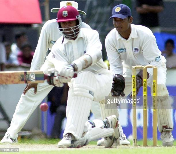 West Indies batsman Darren Ganga sweeps a ball as Sri Lankan wicketkeeper Kumar Sangakkara looks on during the final day of the first cricket Test...