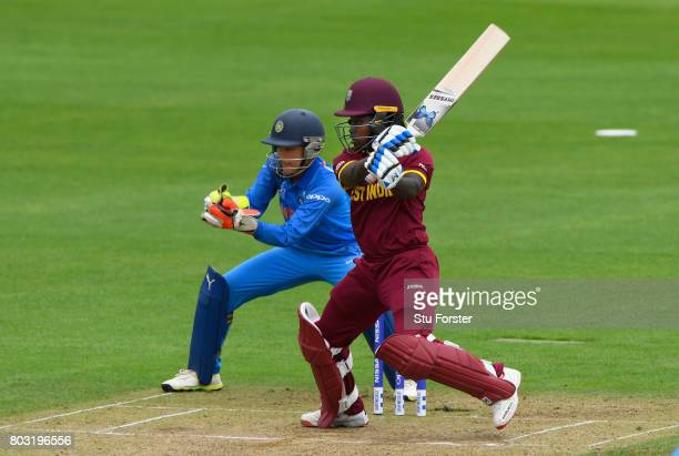 West Indies batsman Deandra Dottin hits out watched by Sushma Verma during the ICC Women's World Cup 2017 match between West Indies and India at The...