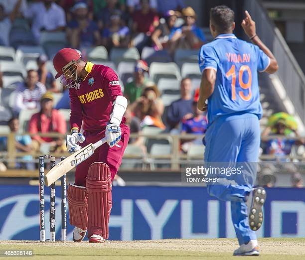 West Indies batsman Denesh Ramdin is bowled by Indian bowler Umesh Yadav during the 2015 Cricket World Cup Pool B match between the West Indies and...