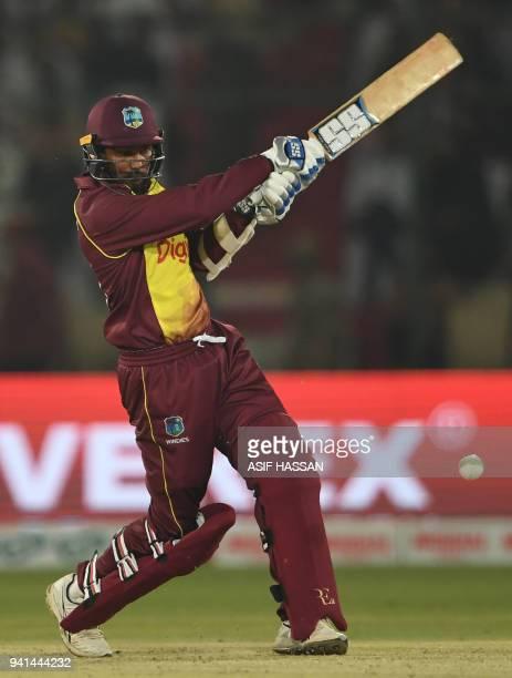 West Indies batsman Denesh Ramdin plays a shot during the third and final Twenty20 International cricket match between Pakistan and West Indies at...