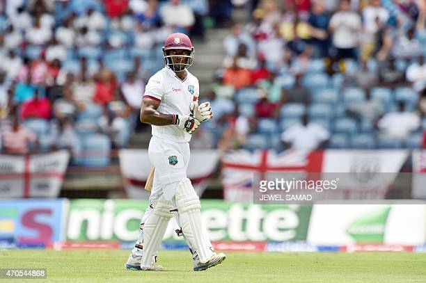 West Indies batsman Devon Smith leaves the field after being dimissed off England's bowler Chris Jordan during the second Test match between West...