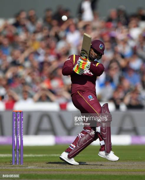 West Indies batsman Evin Lewis hits out during the 1st Royal London One Day International match between England and West Indies at Old Trafford on...