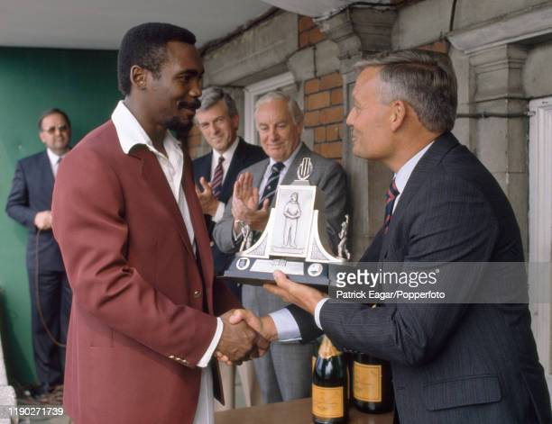 West Indies batsman Gordon Greenidge is presented with the Wisden Trophy after the 5th Test match between England and West Indies at The Oval,...