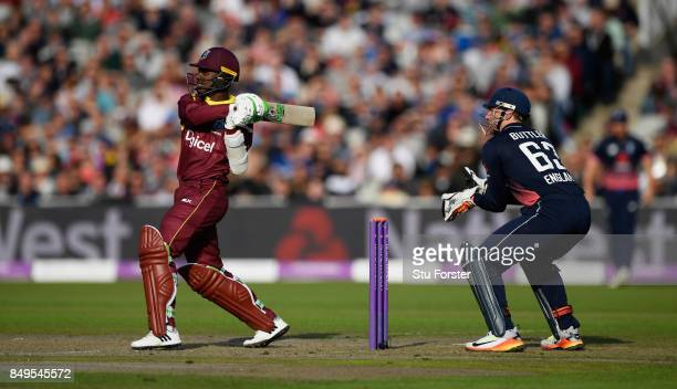 West Indies batsman Jason Mohammed pulls a short ball over the ropes watched by Jos Buttler during the 1st Royal London One Day International match...