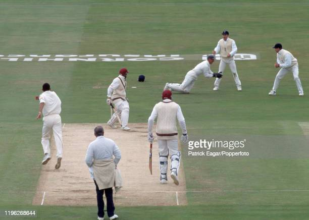 West Indies batsman Keith Arthurton is caught for 42 runs by Alec Stewart of England off the bowling of Phillip deFreitas during the 1st Test match...