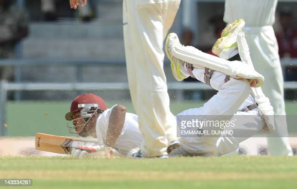 West Indies batsman Kieran Powell dives at the crease during the second day of the third test match between the West Indies and Australia in Roseau,...