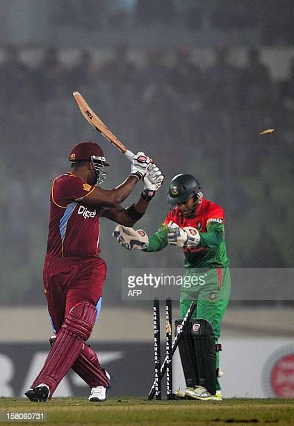 West Indies batsman Kieron Pollard is bowled by Bangladeshi bowler Ziaur Rahman as Bangladesh captain Mushfiqur Rahim looks on during the T20 match...