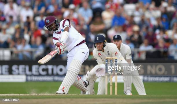 West Indies batsman Kraigg Brathwaite hits out as Jonathan Bairstow reacts during day five of the 2nd Investec Test Match between England and West...