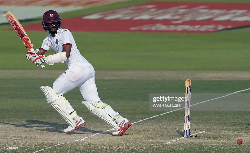 West Indies' batsman Kraigg Brathwaite plays a shot on the fourth day of the second Test between Pakistan and the West Indies at the Sheikh Zayed Cricket Stadium in Abu Dhabi on October 24, 2016. Pakistan set West Indies a target of 456 runs to win the second Test after declaring their second innings at 227-2 on the fourth day in Abu Dhabi. / AFP / AAMIR