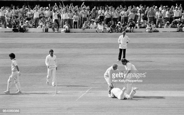 West Indies batsman Larry Gomes walks off after being caught at short leg by Mike Gatting of England off the bowling of Ian Botham during the 2nd...