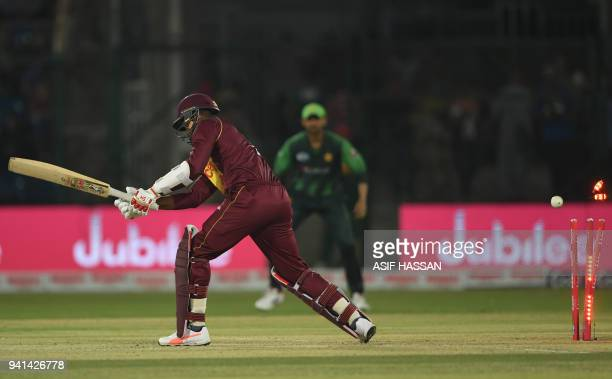 West Indies batsman Marlon Samuels is bowled out by Pakistan spinner Shadab Khan during the third and final Twenty20 International cricket match...