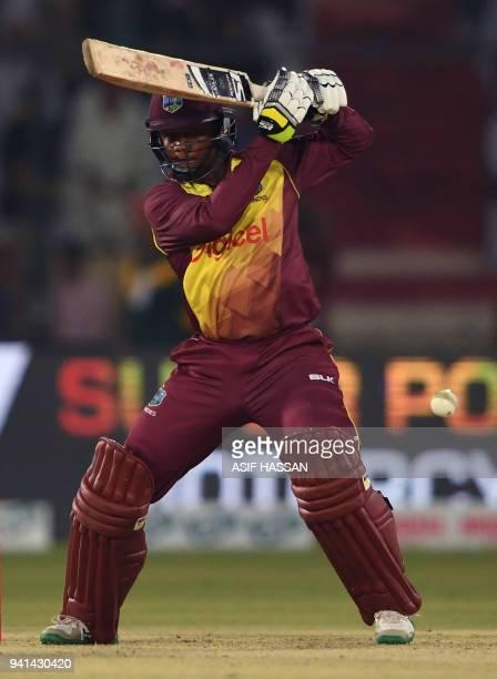 West Indies batsman Marlon Samuels plays a shot during the third and final Twenty20 International cricket match between Pakistan and West Indies at...