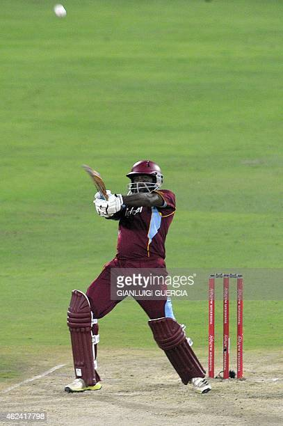 West Indies batsman Narsingh Deonarine hits a 6 during the 5th One Day International cricket match on January 28 2015 at South African Centurion...
