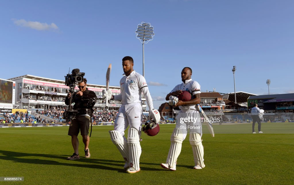 West Indies batsman Shai Hope (l) acknowledges the crowd as he leaves the field with Jermaine Blackwood unbeaten on 147 at the end of day two during day two of the 2nd Investec Test match between England and West Indies at Headingley on August 26, 2017 in Leeds, England.