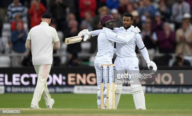 West Indies batsman Shai Hope celebrates his century with Jermaine Blackwood during day five of the 2nd Investec Test Match between England and West...