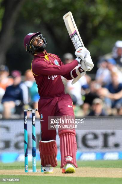 West Indies batsman Shai Hope hits the ball into the air and is caught out during the second oneday international cricket match between New Zealand...