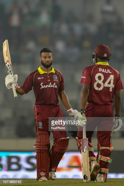 West Indies batsman Shai Hope rais the bat to celebrate after scoring a half century during the second ODI match between Bangladesh against West...
