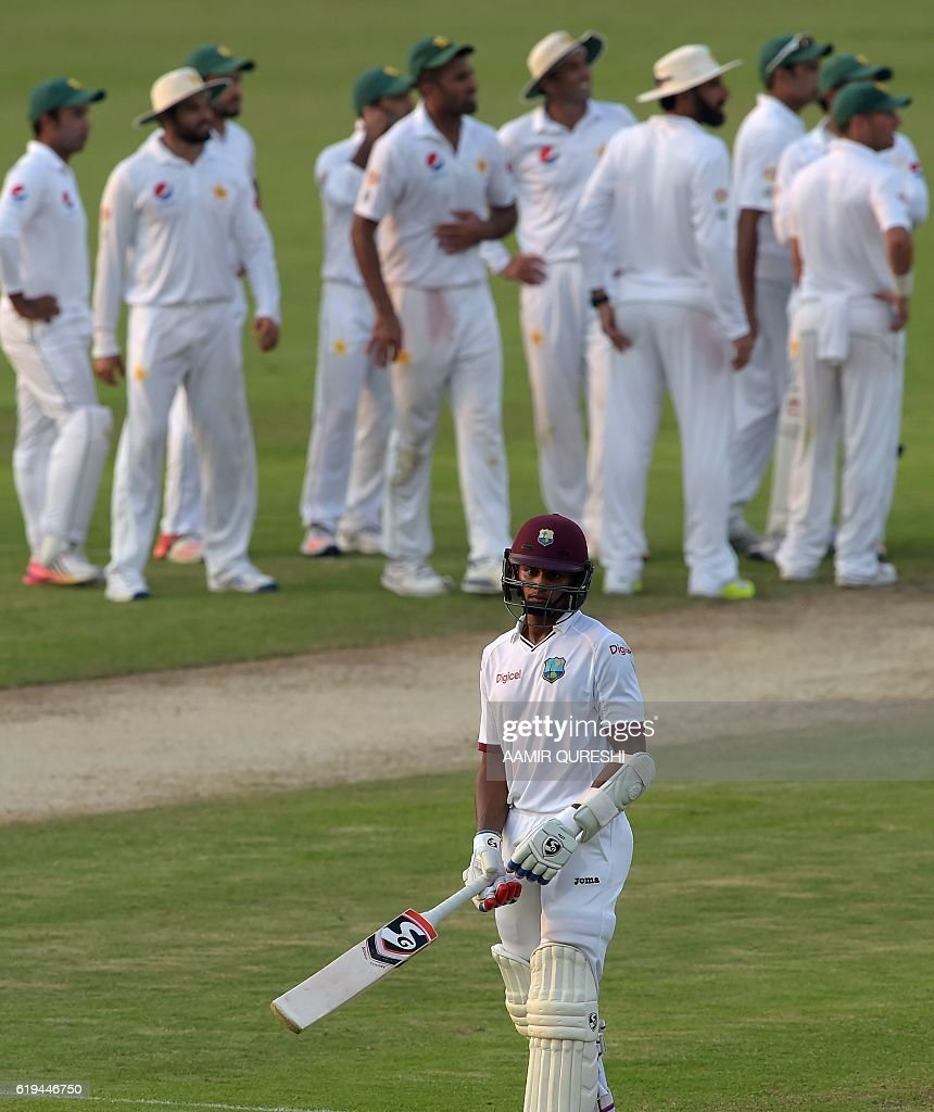 West Indies' batsman Shane Dowrich (front) walks back to the pavilion after his dismissal on the second day of the third and final Test between Pakistan and the West Indies at the Sharjah Cricket Stadium in Sharjah on October 31, 2016. Pakistan, resuming at 255-8, were dismissed for 281 in their first innings on the second day of the third and final Test against West Indies in Sharjah. / AFP / AAMIR