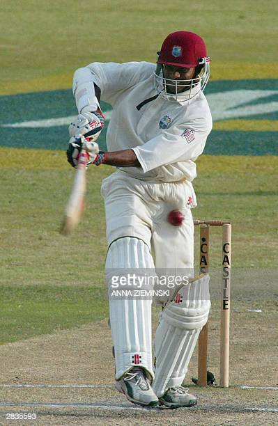 West Indies batsman Shivnarine Chanderpaul is struck by a cricket ball at Kingsmead Cricket Stadium in Durban 29 December 2003 on the fourth day of...