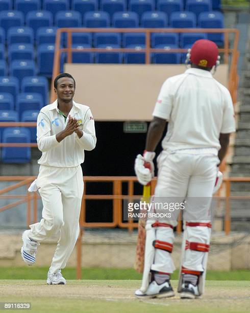 West Indies batsman Tino Best is caught by Bangladesh wicketkeeper Mushfiqur Rahim off Shakib Al Hasan on the fourth day of the second test match at...