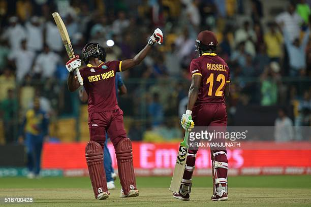 West Indies batsmen Andre Fletcher gestures after winning the match with 84 not out while his partner Andre Russell looks on during the World T20...