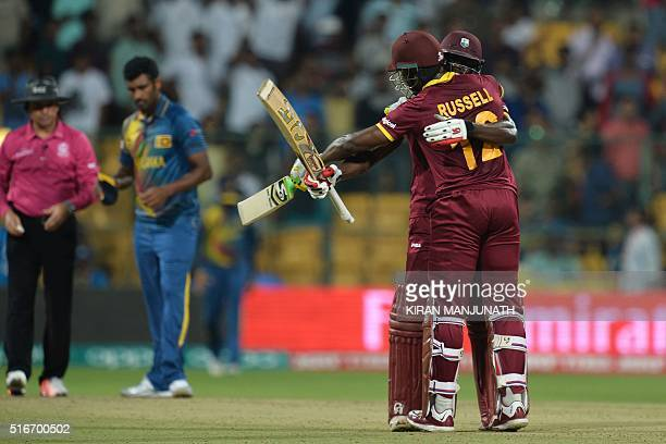 West Indies batsmen Andre Fletcher hugs his partner Andre Russell after winning the match with 84 not out on during the World T20 cricket tournament...
