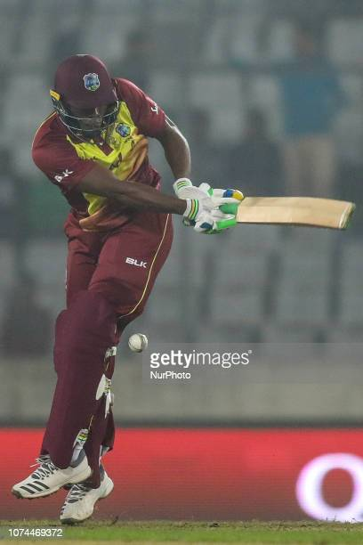 West Indies Bcricketer Sheldon Cottrell plays a shot during the second T20 match between Bangladesh against West Indies in Mirpur Dhaka Bangladesh on...