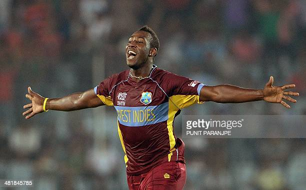 West Indies bowler Andre Russell celebrates after taking the wicket of Pakistan batsman Mohammad Hafeez during the ICC World Twenty20 tournament...