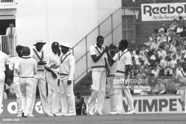 West Indies bowler Curtly Ambrose is congratulated following his dismissal of England captain Graham Gooch who was caught by Gus Logie for only nine...