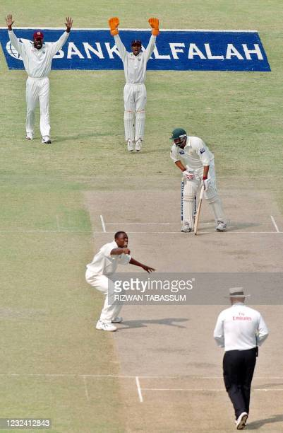 West Indies bowler Darren Powell and his teammate Chris Gayle and wicketkeeper Denesh Ramdin make an unsuccessful attempt at a Leg before Wicket...