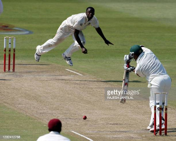 West Indies bowler Darren Powell bowls a shot onto South African batsman Ahswell Prince 11 January 2008, during the second day of the third and final...