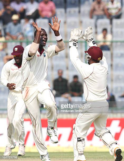 West Indies bowler Darren Sammy celebrates after the wicket of India batsman Gautam Gambhir during the second day of the first Test match between...