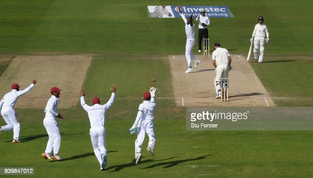 West Indies bowler Jason Holder celebrates after dismissing Alastair Cook caught by wicketkeeper Shane Dorwich during day three of the 2nd Investec...