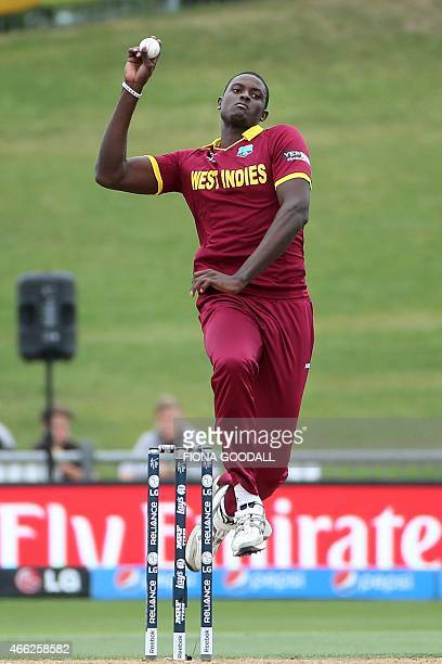 West Indies bowler Jason Holder runs during the Pool B 2015 Cricket World Cup match between West Indies and United Arab Emirates at McLean Park in...