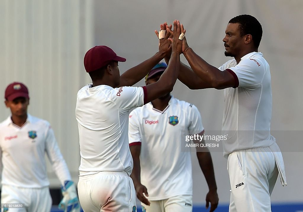 West Indies' bowler Shannon Gabriel (R) celebrates with teammates after the dismissal of Pakistani batsman Sarfraz Ahmed unseen on the first day of the third and final Test between Pakistan and West Indies at the Sharjah Cricket Stadium in Sharjah on October 30, 2016. Pakistan finished the opening day of the third and final Test against West Indies on 255-8 in Sharjah. / AFP / AAMIR