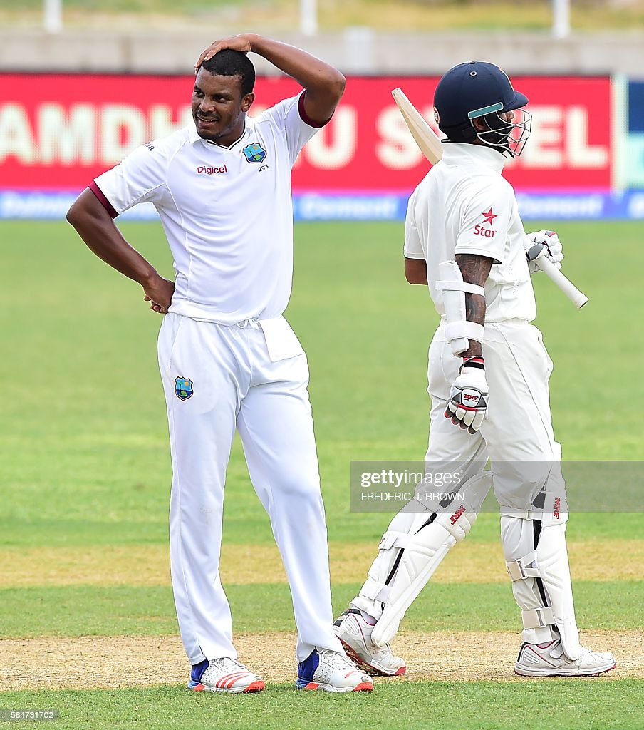 West Indies bowler Shannon Gabriel reacts after India batsman Shikhar Dhawan pulled amidst his delivery due to a distraction in the stands on July 30, 2016 in Kingston, Jamaica on the first day of the 2nd Test between India and the West Indies. / AFP / Frederic J. BROWN