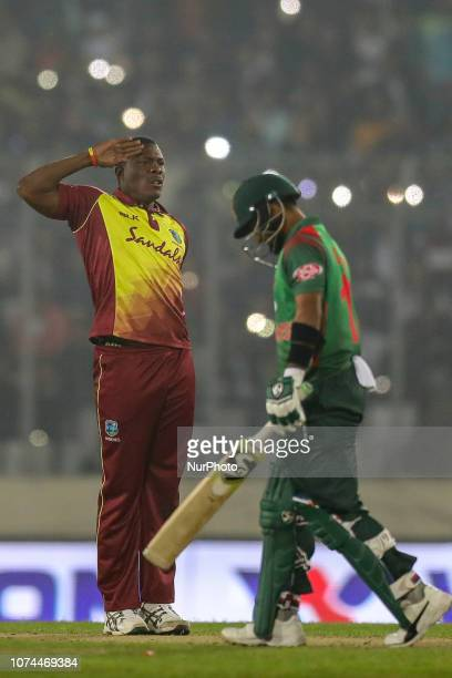 West Indies bowler Sheldon Cottrell celebrate after the dismissal of Bangladesh's Liton Das during the second T20 match between Bangladesh against...
