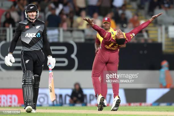 West Indies bowler Sheldon Cottrell celebrates taking the wicket of New Zealands Martin Guptill during the Twenty20 international cricket match...