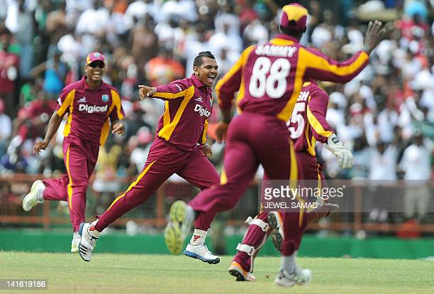West Indies bowler Sunil Narine celebrates after bowling out Australian cricketer Matthew Wade during the third-of-five One Day International matches...