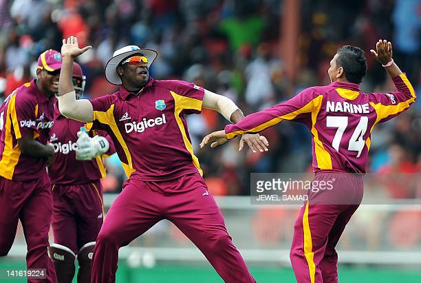 West Indies bowler Sunil Narine celebrates with teammates after bowling out Australian cricketer Matthew Wade during the third-of-five One Day...