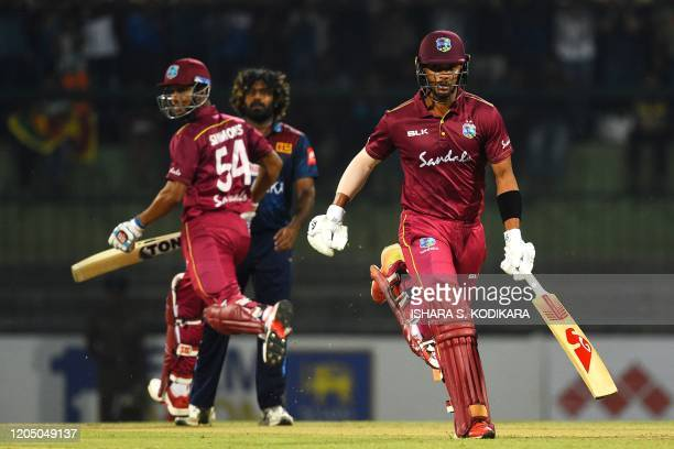 West Indies' Brandon King and his teammate Lendl Simmons run between the wickets during the first Twenty20 international cricket match of a twomatch...