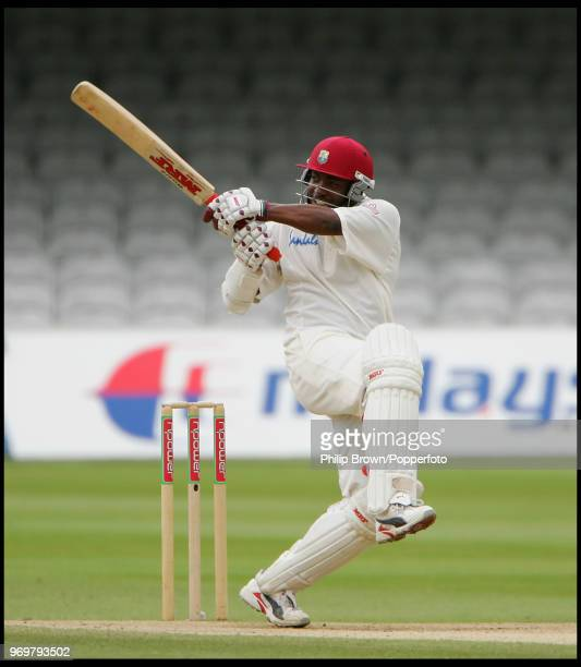 West Indies captain Brian Lara hits out during the 1st Test match between England and West Indies at Lord's Cricket Ground, London, 26th July 2004....
