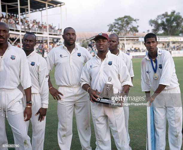 West Indies captain Brian Lara holds the Wisden Trophy while standing with his team after West Indies won the 6th Test match between West Indies and...