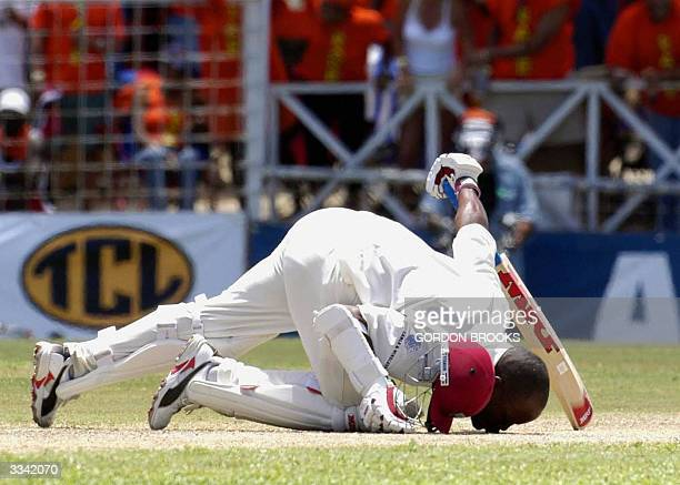 West Indies captain Brian Lara kisses the ground 12 April, 2004 in celebration of his record breaking 385 on the third day of the fourth and final...