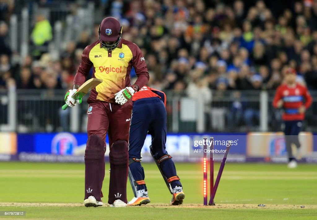 West Indies' captain Carlos Brathwaite walks back to the pavilion after losing his wicket for 2 during the T20 International cricket match between England and West Indies at The Emirates Riverside, Chester-le-Street in north east England on September 16, 2017. England won the toss and elected to bowl against West Indies in the lone Twenty20 international at Chester-le-Street on Saturday. / AFP PHOTO / Lindsey PARNABY / RESTRICTED